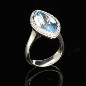 Diamond and blue topaz ring